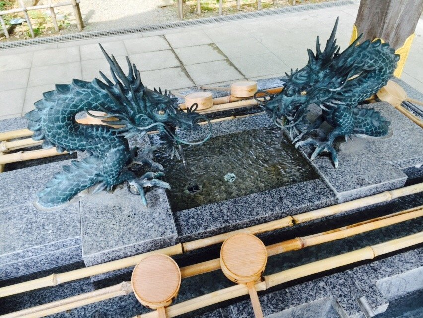 Dragons guard sacred water outside the gate to the main building