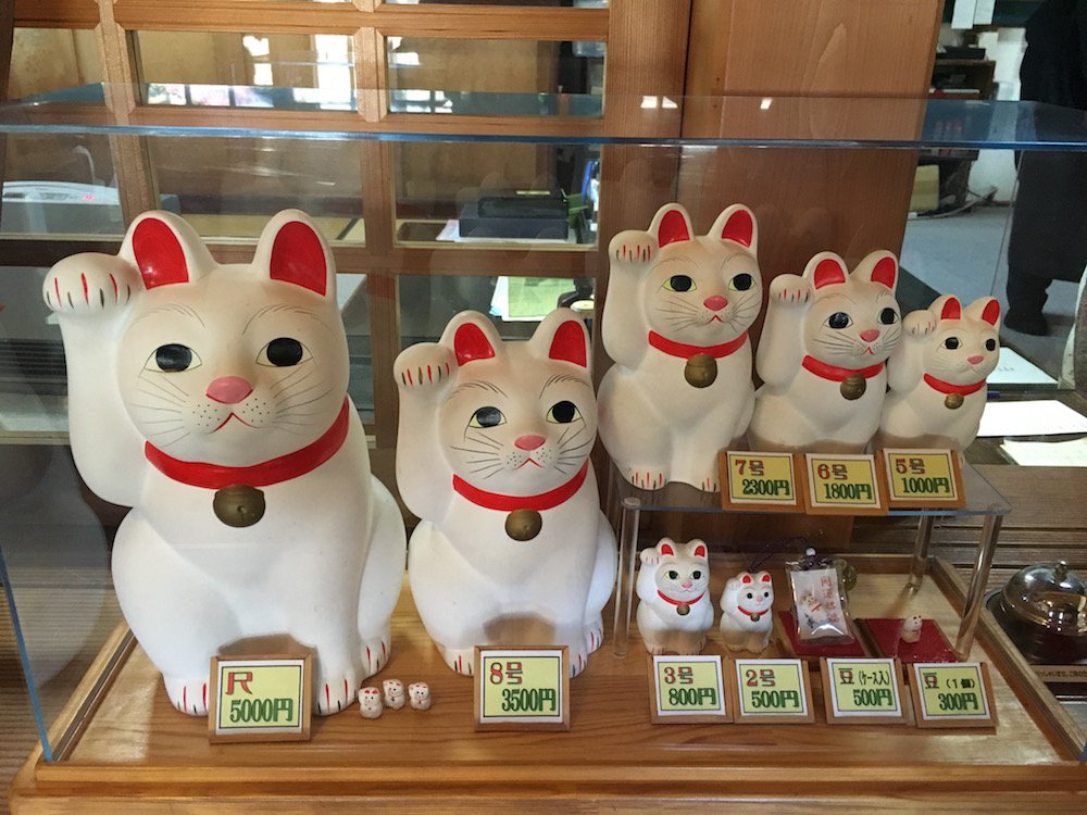 Which one? Maneki Neko of varying sizes