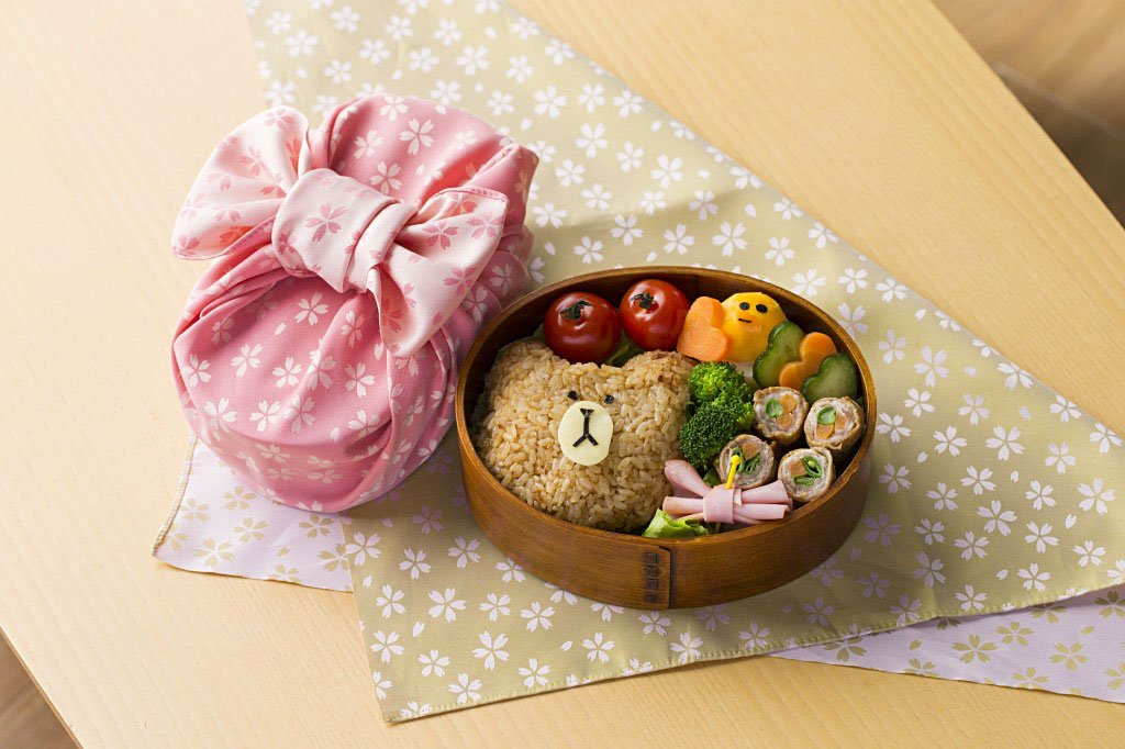 Obento lunch box wrapped in a sakura cherry furoshiki