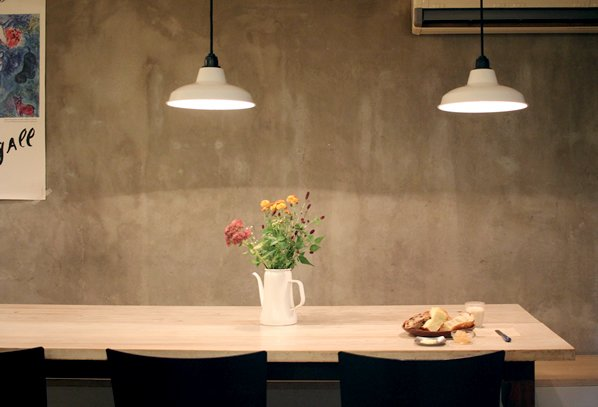 This wooden long table sits six people and there are four smaller tables