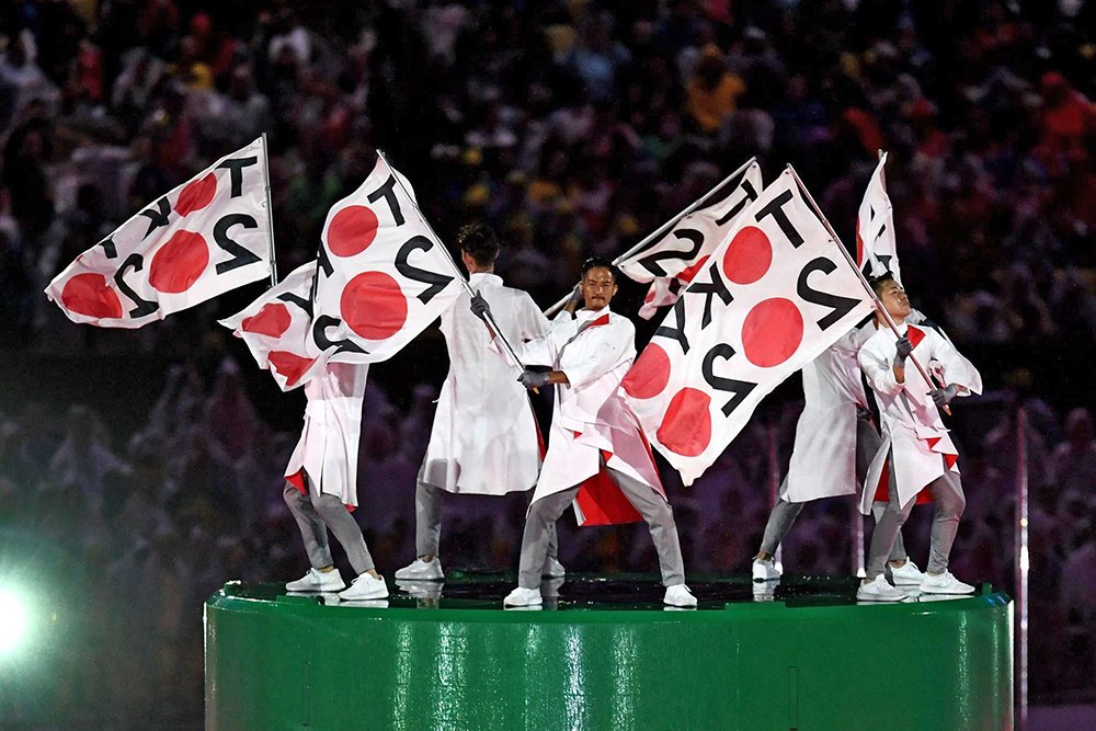 Tokyo governor Yuriko Koike will receive and wave the Olympic flag